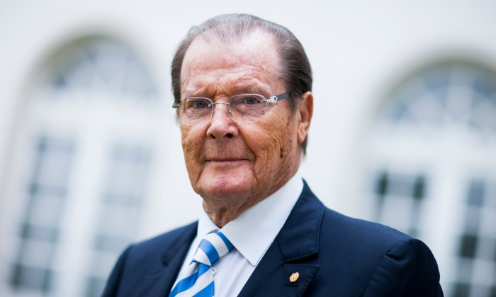 25 Jun 2013, Aachen, Germany --- British actor Sir Roger Moore poses before an interview in Aachen, Germany, 25 June 2013. Photo: ROLF VENNENBERND --- Image by © Rolf Vennenbernd/dpa/Corbis