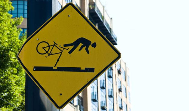 54eab93cb7be0_-_11-bike-on-tracks-wacky-road-signs-1