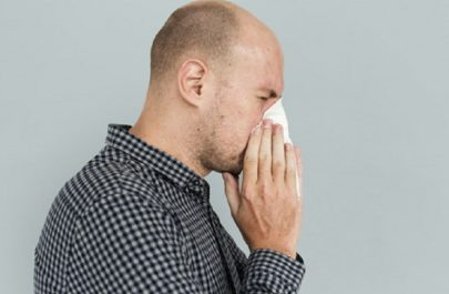 Man sneezing blowing nose sickness